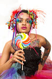 Retro Candy Girl. Retro image of a beautiful young model with candy makeup holding a lollipop Stock Image