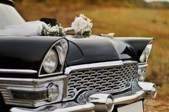 Retro car. Decorated for wedding Royalty Free Stock Photos