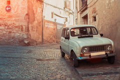 Retro car on ancient street of Girona, paving stone Stock Images