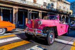Retro car as taxi with tourists in Havana Cuba stock photos