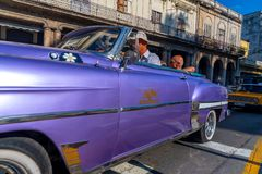 Retro car as taxi with tourists in Havana Cuba royalty free stock image