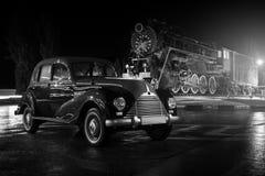 Retro bmw car at rain night near train  1940s Stock Photos
