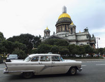 Retro car on a background of Saint Isaac's Cathedral. Russian retro car on a background of St. Isaac's Cathedral in Saint-Petersburg Stock Image