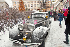Retro car and book character Conan Doyle's birthday January 4, 2. Retro car Conan Doyle's birthday January 4, 2015 Sherlock Holmes on the streets of Riga, Latvia Royalty Free Stock Images