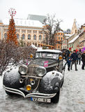 Retro car and book character Conan Doyle's birthday 04/01/2015 S. Retro car Conan Doyle's birthday 04/01/2015 Sherlock Holmes on the streets of Riga, Latvia Royalty Free Stock Image