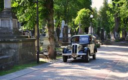 Retro car,  Cemetery, necropolis. Retro car on Lychakiv Cemetery, Lviv, Ukraine, Europe Royalty Free Stock Images