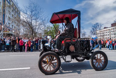 Retro car of 19 century participates in parade Royalty Free Stock Images