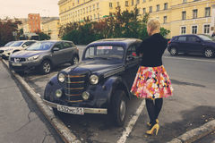 retro car and vintage girl in Murmansk Stock Image