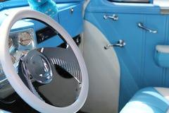 Retro car dash. Steering wheel, dash and front seat of a vintage car stock photos