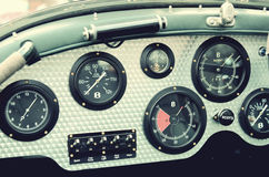 Retro car dashboard with gauges Stock Photos