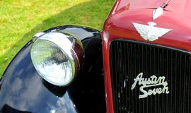 Retro car detail. NOTTINGHAM, UK - JUNE 1, 2014: Rare Austin Seven vintage car for displayed at the retro car show in Nottingham, England Royalty Free Stock Images