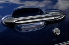 Retro car door handle chrome on dark blue Royalty Free Stock Images