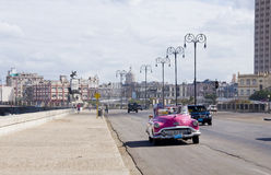Retro car driving along Malecon Stock Photo