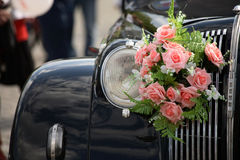 Retro car with flowers Royalty Free Stock Photos