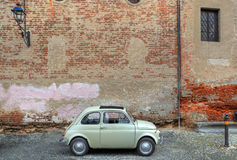 Retro car in front of ancient wall. Stock Photography