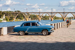 Retro car GAZ-21 Volga parked on the embankment by the river Royalty Free Stock Photography