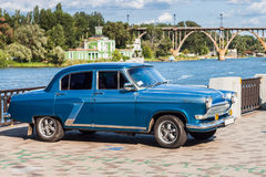 Retro car GAZ-21 Volga parked on the embankment by the river Royalty Free Stock Images