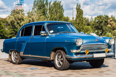 Retro car GAZ-21 Volga parked on the embankment by the river Stock Photography