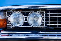 Retro car headlights Stock Images