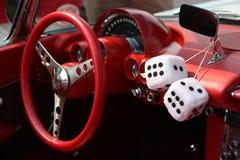 Retro Car Interior. Retro red vintage car interior with fuzzy dice Stock Photos