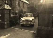 Retro car leaving castle in Glenveagh National Park royalty free stock photography
