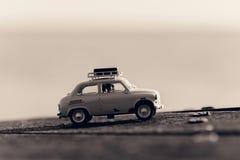 Retro  car with luggage on top. Macro photo. Sepia toned image Royalty Free Stock Photo