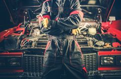 Retro Car Mechanic Theme. Men and His Restored American Classic Car stock photos
