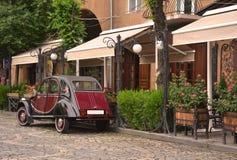 Retro car near outdoor cafe. Yerevan, Armenia Stock Photos