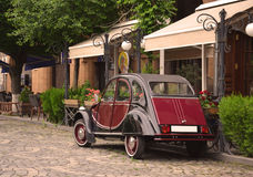Retro car near outdoor cafe. Yerevan, Armenia Royalty Free Stock Photography
