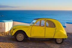 Retro car on the ocean Stock Photos