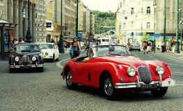 Retro car at old street in Prague. Royalty Free Stock Images