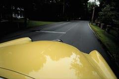 Retro car on open road Stock Photo