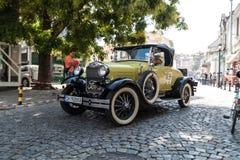 Retro car parade Stock Images