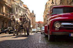 Retro car parked in old European city street. Beautiful capital city of Czech Republic Stock Photos