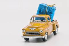 Retro car pickup with gift box isolated.  royalty free stock image