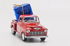 Retro car pickup with gift box isolated.  stock images