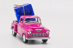 Retro car pickup with gift box isolated.  royalty free stock photo