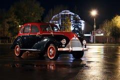 Retro car at rain night near lamp bmw 1940s Royalty Free Stock Photos