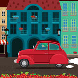 Retro car rides through the old town Royalty Free Stock Image