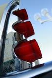 Retro car's tail fin. Sky courtesy of sunny Florida Royalty Free Stock Photo