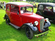 Retro car show. NOTTINGHAM, UK - JUNE 1, 2014: Rare red Austin vintage car for displayed at the retro car show in Nottingham, England Royalty Free Stock Photo