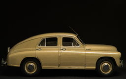 Retro car side view on a black background Stock Photography