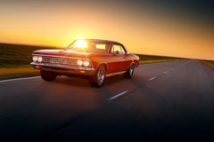 Fast drive retro red car speed on the road 1960s chevrolet cheville malibu Royalty Free Stock Images