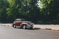 Retro car standing on road in city royalty free stock images