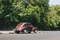 Retro car standing on road in city stock photos