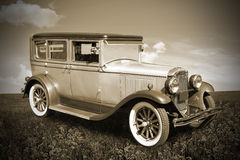 Retro car. The retro car stands in a field. Old photo Royalty Free Stock Images