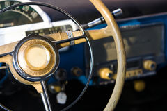 Retro car steering wheel. Gaz-21 car on steering wheel royalty free stock photography