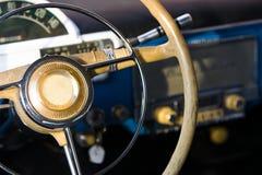 Retro car steering wheel. Gaz-21 car on steering wheel Royalty Free Stock Photography