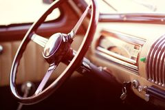 Retro car steering wheel. With keys inside the car Stock Photography