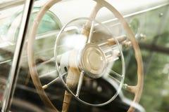 Retro car steering wheel. Through the glass Royalty Free Stock Image